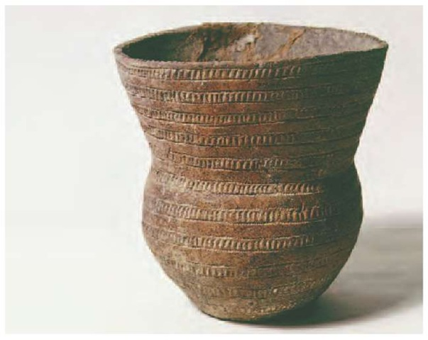 Bell Beakers from West to East Bell-shaped beaker with plain and decorated horizontal zones fram Late Neolithic burial near Salisbury in southern England, h. 2200 b.c.