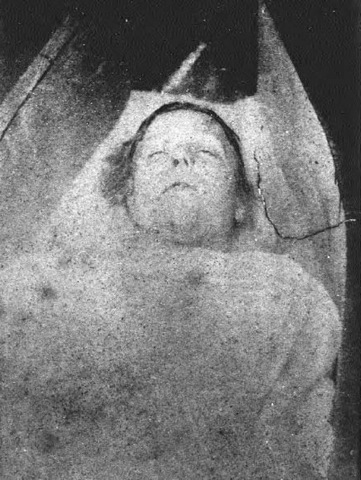 Mary Ann Nichols lying in a coffin shell at the mortuary. The photograph is of poor quality, but her general features can be plainly discerned.