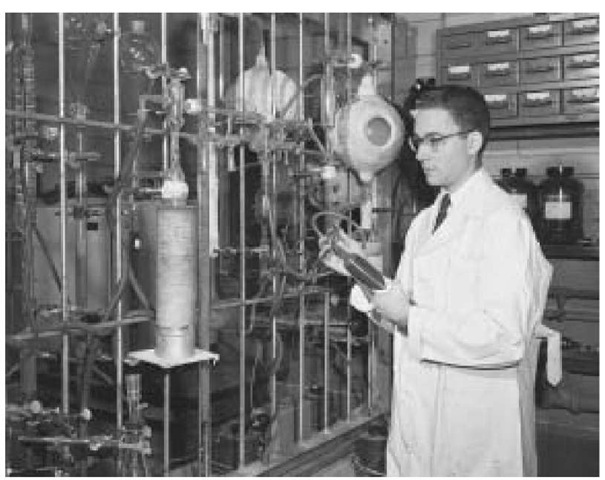 Stanley Miller working in a laboratory in which he created conditions similar to Earth 3.5 billion years ago and created elementary organic molecules essential for life.