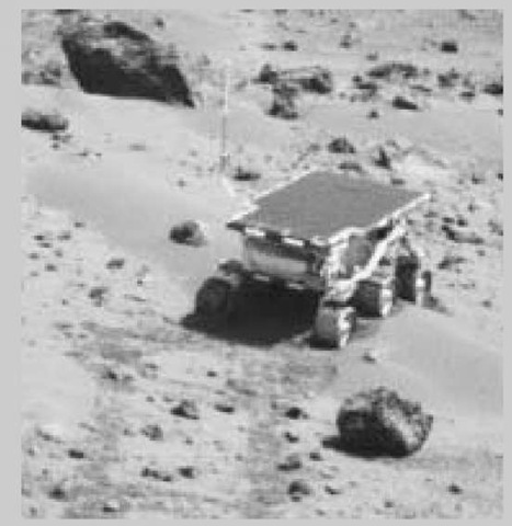 The Sojourner rover performs experiments on Mars.