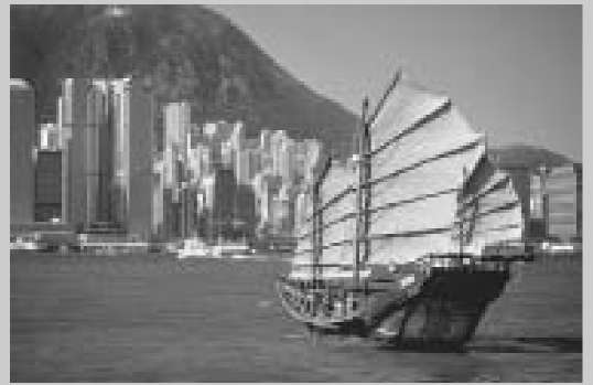 A junk, a form of boat popular in the waters, sails into the port of Honk Kong, China.