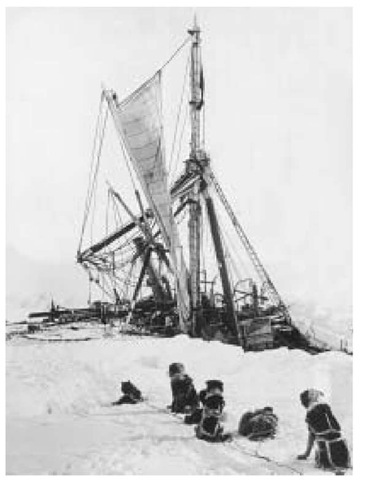 During the 1915 British Imperial Trans-Antarctic Expedition, Sir Edmund Shackleton's boat Endurance sinks in the pack ice of the Weddell Sea while sled dogs sit and watch.