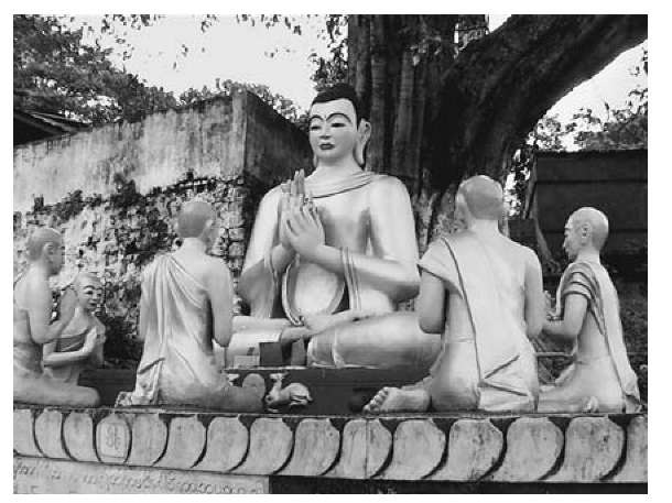The Buddha preaching his first sermon to the five wandering ascetics, a common theme reproduced in Theravada temples and folklore; from Mt. Popa, central Myanmar (Burma)