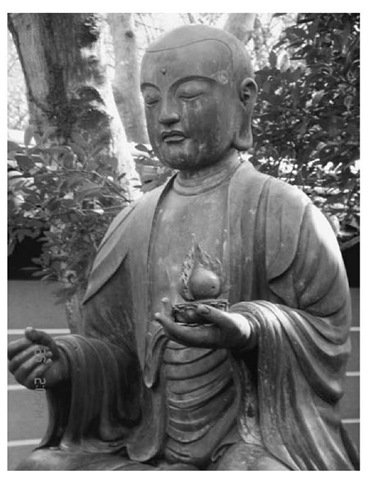 Stone image of Muso Kokushi (1327-1351), Rinzai Zen priest, founder of Zuisen-ji and builder of many Japanese gardens, in the garden of the Zuisen-ji, Kamakura, Japan
