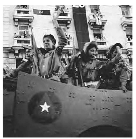 Women Cuban rebel soldiers wave on arrival in Havana, Cuba, 1959.
