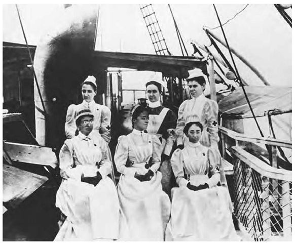 Nurses aboard an Army hospital ship doing medical work in Cuba during Spanish-American War.
