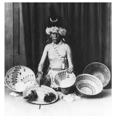 A Yokuts shaman displays his baskets and some of his medicine equipment in 1920. Shamans derived power from spirit animals via dreams or vision quests. Chronically unsuccessful shamans might be accused of sorcery and killed.