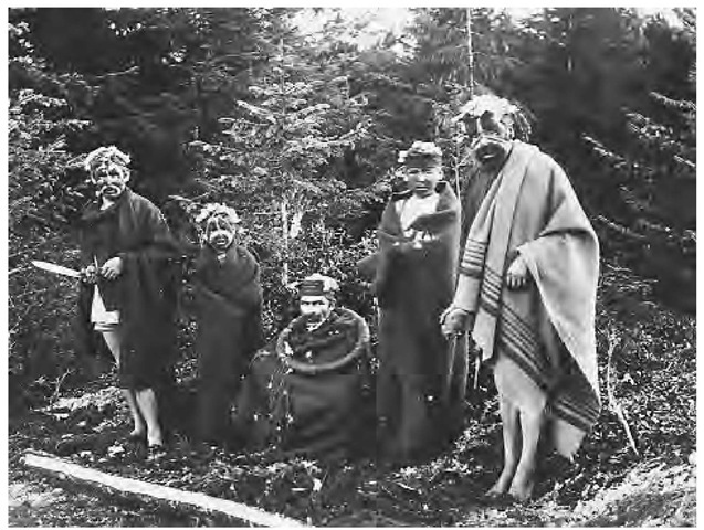 Kwakiutl tribe members participate in a winter initiation ceremony, 1892. The winter ceremonials were based on complex mythological themes and involved representations of supernatural beings and stories of ancestral contact with them. Winter was considered a sacred season because the supernaturals were said to be present at that time.