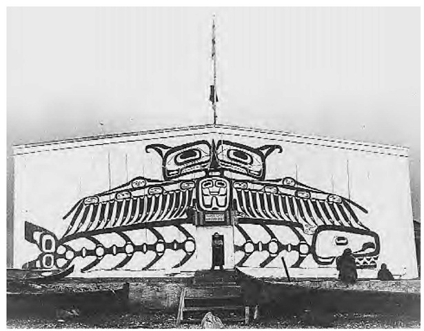 As a people, the Kwakiutl were artists. Wooden objects such as massive house posts, totem poles, masks, rattles, feast dishes, and other objects used for crest displays were carved or painted. On this old house at Alert Bay in British Columbia, the legendary thunderbird is depicted carrying off a whale (1902).