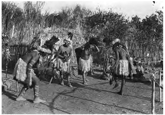 Paiute men of California's Owens Valley wear ceremonial skirts of magpie feathers and twisted eagle down for a dance staged in 1932. Shell necklaces and face and body paint were usually reserved for dances.