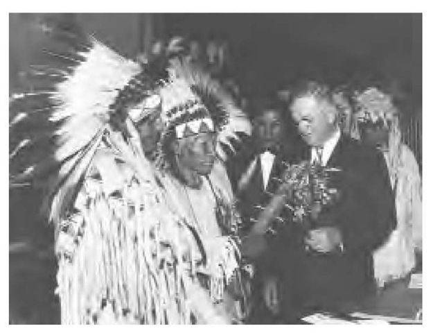Secretary of the Interior Harold Ickes accepts the new constitution and by-laws from leaders of Montana's Flathead Reservation, October 29, 1935.
