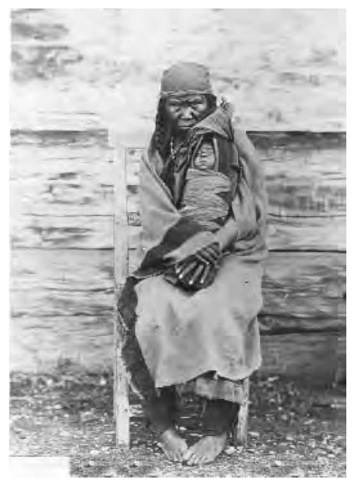 This woman is wearing a Hudson's Bay blanket, a popular trade item for the Colvilles. The name of this tribe is derived from the Colville River and Fort Colville, a Hudson's Bay Company (HBC) trading post, which in turn took their names from Eden Colville, an HBC governor.
