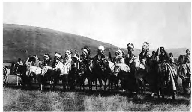 Nez Perce warriors on horseback. By virtue of their being the most powerful Plateau tribe, the Nez Perce played a central role in regional peace and war. Men and horses were painted and decorated for war.