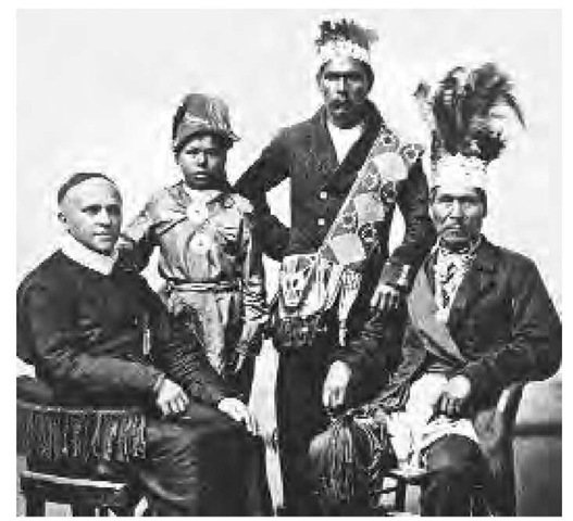 With their growing involvement in the French fur trade, the Passamaquoddy soon became dependent on items of non-native manufacture. They also accepted Catholic missionaries. Pictured here are three Maine Indians with a Jesuit priest.