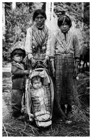 Mrs. Sam Zulin and her three children, pictured in 1924 while visiting Bella Coola, British Columbia.