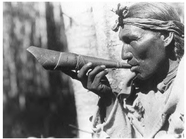 Cree men were considered superb hunters. They targeted caribou, elk, moose, and beaver. This man is imitating a moose call with an old-style birch-bark device to amplify the sound.