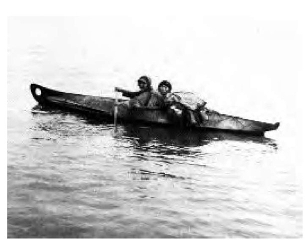 Although they varied somewhat from place to place, kayaks were basically one-man, closed-deck hunting canoes. A wooden frame was lashed with sinew and covered with sewn seal or caribou skin. Men propelled them with double-bladed paddles, as shown in this 1906 photograph, and used them mainly for hunting.