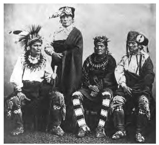 A delegation of Sauk, Fox, and Ioway chiefs, photographed in 1866, wears headgear that includes, from left to right, a cloth turban with roach, an otter-skin turban with beaded tail, a cloth turban, and a fur turban with a shell-disk decoration. Their moccasins and leggings are beaded with either geometric or floral designs.