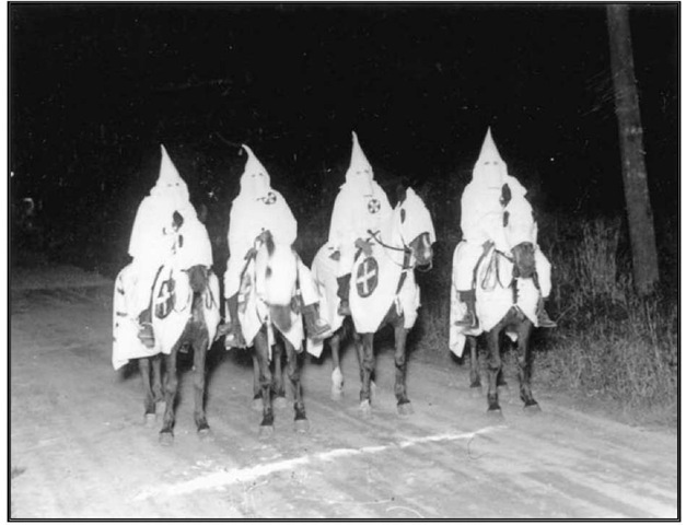 A Ku Klux Klan gathering in Point Pleasant c. 1920s, where even the horses were hooded.