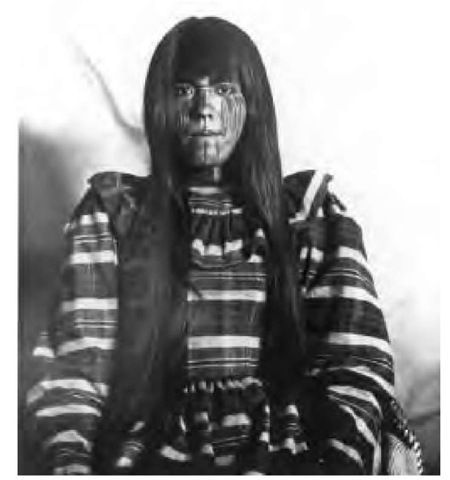 Pima women grew their hair long, wore ear pendants of turquoise and other stones, and tattooed and painted their bodies. This woman's elaborate face paint may denote her family or simply be ornamental.