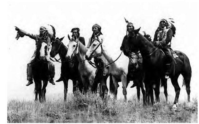 American Indians on horseback at Buffalo Run, Yellowstone, circa 1924.