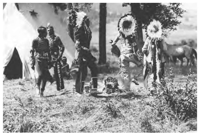 American Indians near lodges at Buffalo Run, Yellowstone, circa 1924.