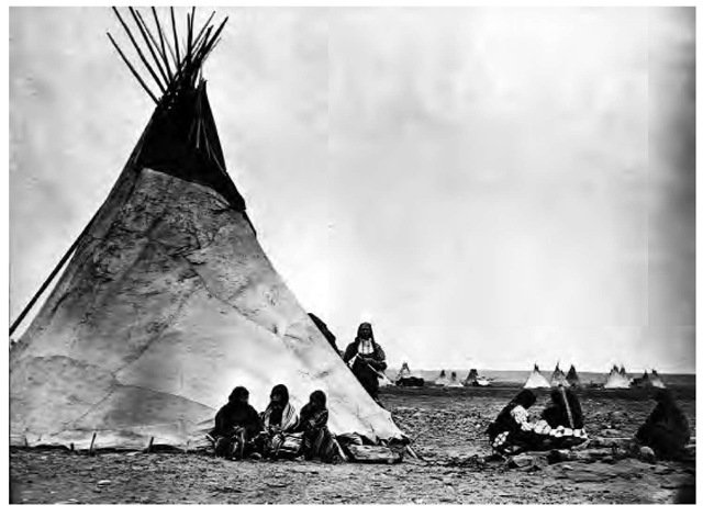 Since the nineteenth century, Arapaho women have made buffalo-skin tipis. In this 1913 photograph, the patches and heavy seams characteristic of buffalo-hide tipis are clearly visible.