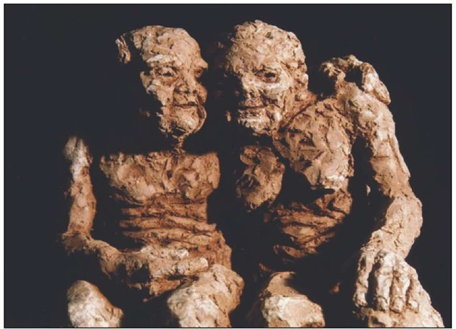 A sculpture of an elderly couple in their 80s showing the general effects of age and the age-related convergence of physical characteristics described in the introduction.