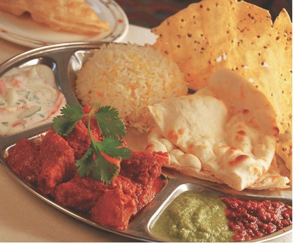 A favorite Indian dinner includes the hot and spicy stew called roghan josh, dal, rice, and flat breads.