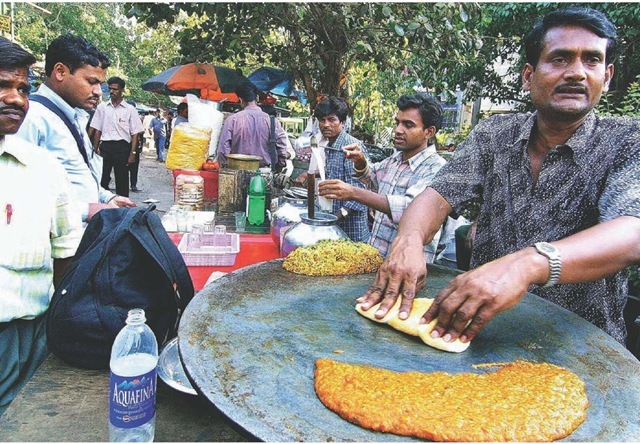A Mumbai street vendor prepares pao-bhaji, Indian fast food, for hungry on-the-go customers.
