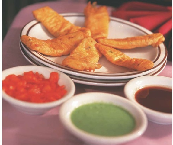 Pakoras, fritters made from ground vegetables, are often served with a variety of chutneys.