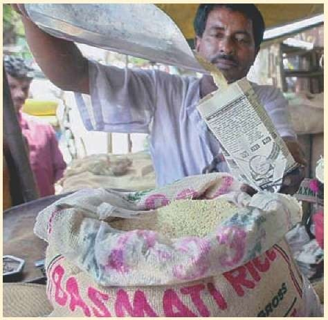 A rice vendor sells packets of Basmati rice.