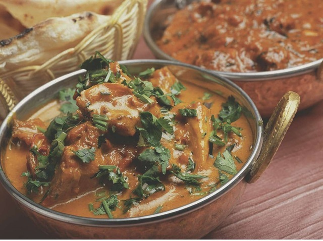Spicy chicken curry is just one of many curries enjoyed by Indians.