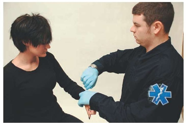 Paramedic assessing a patient's respirations.