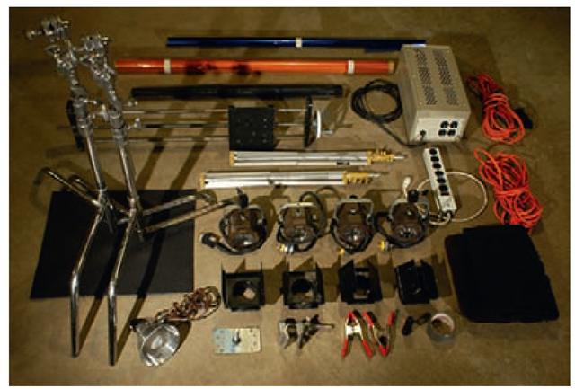 Image of grip equipment (lights, flags, voltage regulator, c-stands).