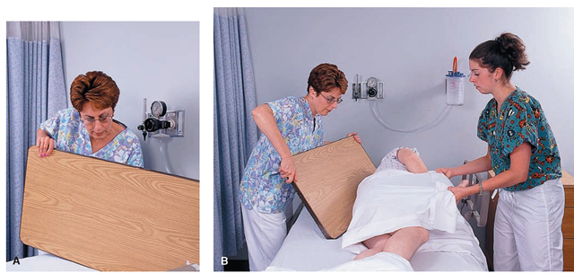 (A) Removing the headboard for cardiopulmonary resuscitation (CPR). (B) The headboard is placed under the client's upper body to provide a firm surface for resuscitation. A transfer board may also be used for this purpose.